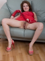 Sandy strips nude on her favorite green chair